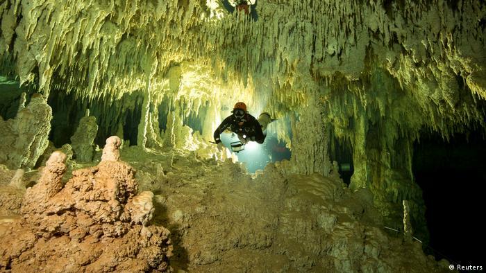A scientist explores an underwater cavern