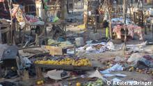 Fruits and scattered stalls are seen at the Muna Garage after two male suicide bombers detonated the bombs in Maiduguri, Nigeria January 17, 2018. REUTERS/Stringer NO RESALES. NO ARCHIVES.