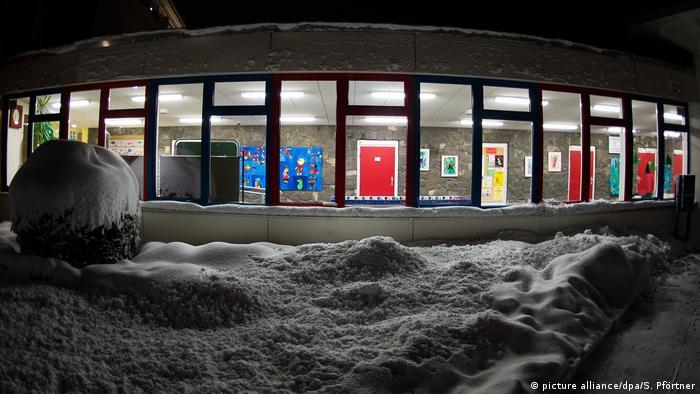 snow in front of school building