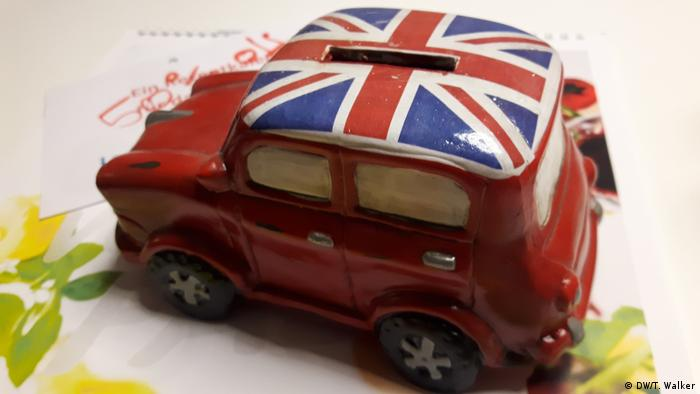 A car money box with a Union Jack on the roof