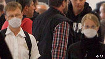 People wearing face masks at Duesseldorf airport