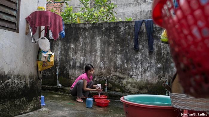 Vietnam housewife Oxfam wealth inequality