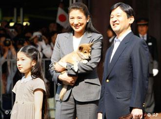Japan's Crown Prince Naruhito, right, Crown Princess Masako with family dog Yuri and their daughter Princess Aiko arrive at Utsunomiya station, north of Tokyo, Japan, Saturday, May 2, 2009. They are on their way to the nearby imperial ranch. (AP Photo/Shizuo Kambayashi)