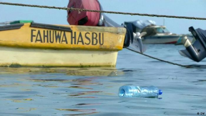 Yellow boat in polluted water in Africa