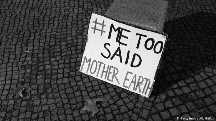A simple sign that reads #MeToo said Mother Earth