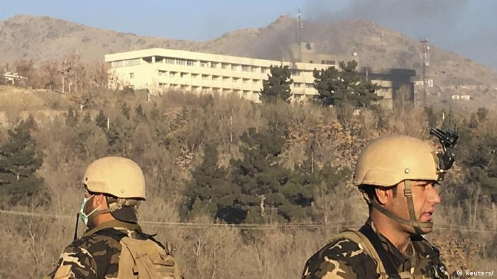 Soldiers stand guard outside the Intercontinental Hotel in Kabul