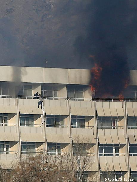 Guests use bedsheets to try to escape from the burning Intercontinental during Saturday's Taliban attack