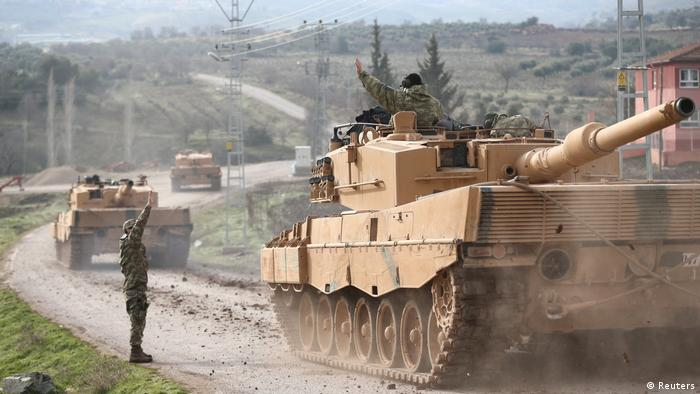 German-made Leopard tanks move along a road on on the Syrian border (Reuters)