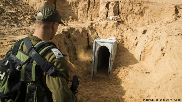 An Israeli soldier looks at a concrete tunnel built by Palestinians in Gaza