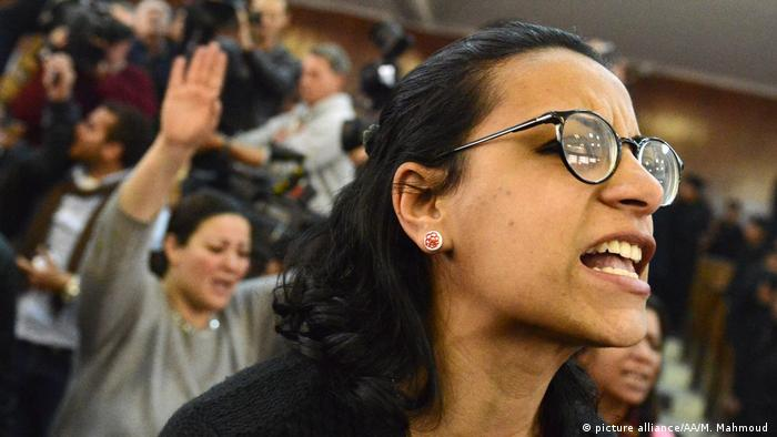 Egyptian activist Mahinour el-Masry protests in court as she is sentenced.