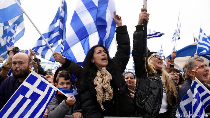 Protesters wave Greek flags