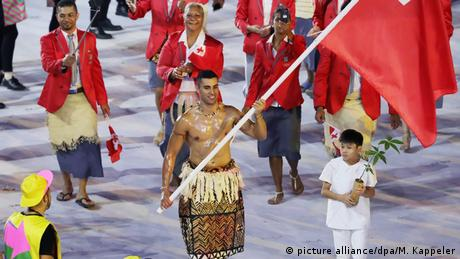 Pita Taufatofua carrying his flag at the opening ceremony in Brazil