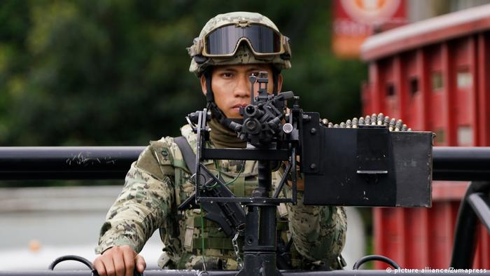 A Mexican soldier stands guard