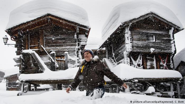 A man wades through snow