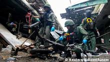 ATTENTION EDITORS - VISUAL COVERAGE OF SCENES OF INJURY OR DEATH Military personnel inspect the site of a bomb attack at a market in the southern province of Yala, Thailand, January 22, 2018. REUTERS/Surapan Boonthanom TEMPLATE OUT