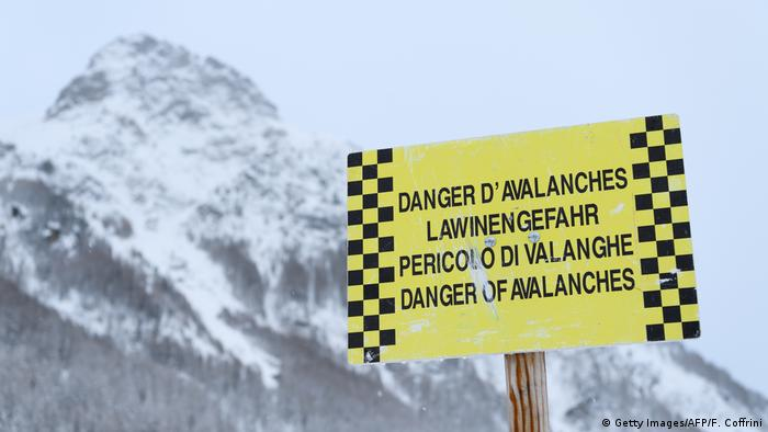 An avalanche warning board on display at a closed area in the small resort of Zinal, Swiss Alps