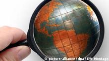 Symbolbild Globus Welt Lupe