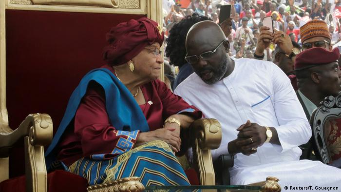 Sirleaf and her successor, George Weah, during the inauguration (Reuters/T. Gouegnon)