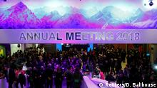 Attendees take part at a reception event after the Crystal Award ceremony during the World Economic Forum (WEF) annual meeting in Davos, Switzerland January 22, 2018. REUTERS/Denis Balibouse