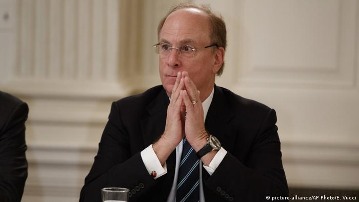 BlackRock CEO Larry Fink listens during a meeting between President Donald Trump and business leaders in the State Dining Room of the White House