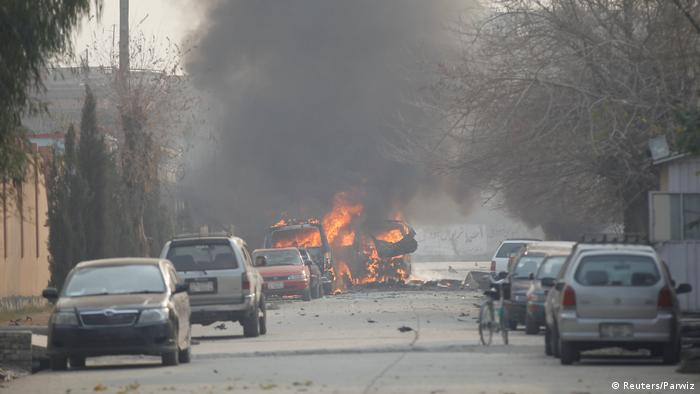 Vehicles on fire after the blast in Jalalabad