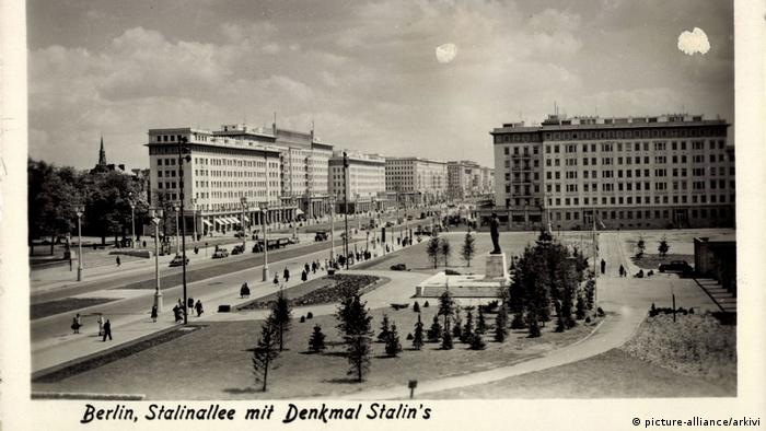 Berlin Friedrichshain,Stalinallee with a statue to Stalin in the foreground