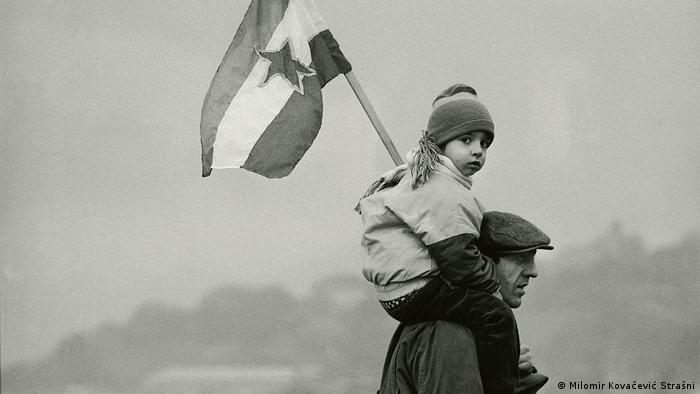 A child holding the Yugoslavian flag – from the Once Upon a Time in Yugoslavia exhibition by Milomir Kovacevic