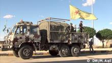 YPG Syrien Kurdische Soldaten mit Tarn-Lastwagen