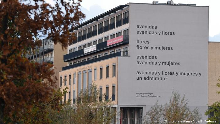 The facade of the Alice Salomon Hochschule in Berlin showing the poem mural