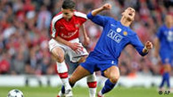 Manchester United's Cristiano Ronaldo, right, and Arsenal's Robin Van Persie battle for the ball during the Champions League semi-final second leg soccer match at the Emirates stadium in London, Tuesday, May 5, 2009.
