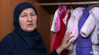 Petimat Salamova and the clothes of her missing grandchildren