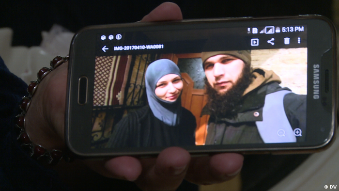 Missing Chechen youths on a mobile phone display