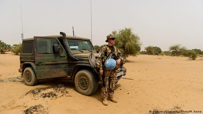 A german solider in front of a truck in Mali