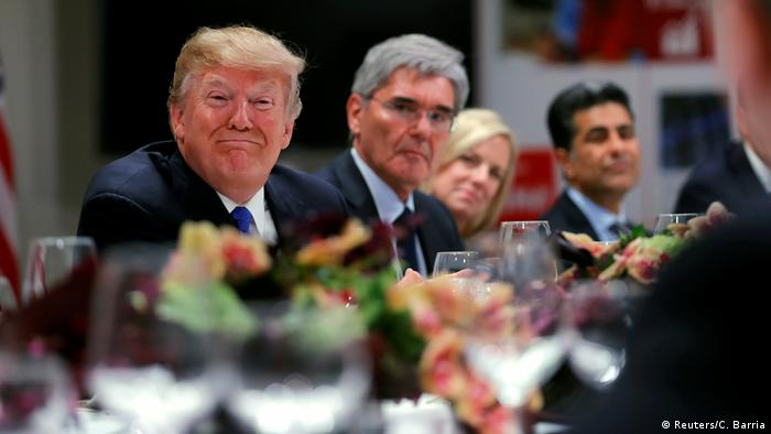 Donald Trump, business leaders and cabinet members dine together at Davos (Reuters/C. Barria)