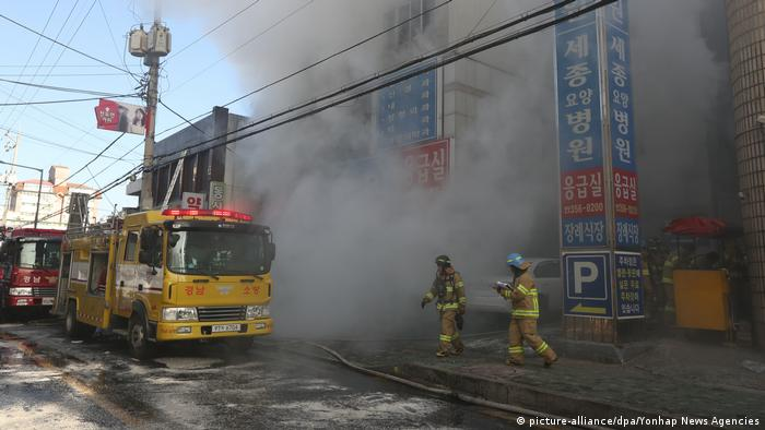 Firefighters try to put out a fire at a hospital in Miryang in southeastern South Korea