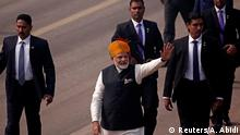 India's Prime Minister Narendra Modi waves towards the crowd as he leaves after attending the Republic Day parade in New Delhi, India January 26, 2018. REUTERS/Adnan Abidi