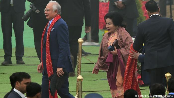Malaysian Prime Minister Najib Razak walks through a ceremony in India.
