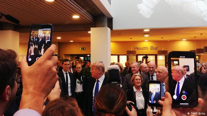 Trump surrounded by media peopole