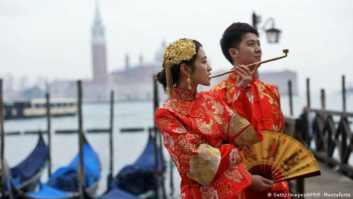 Revellers dressed in Asian costumes take part in the Venice Carnival