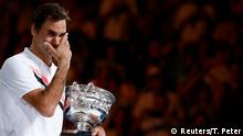 28.01.2018+++Melbourne, Australien+++ Tennis - Australian Open - Men's singles final - Rod Laver Arena, Melbourne, Australia, January 28, 2018. Winner Roger Federer of Switzerland cries while holding the trophy. REUTERS/Thomas Peter TPX IMAGES OF THE DAY