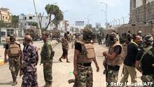 Yemeni men and security forces inspect the site of a suicide bombing in the southern port city of Aden, on November 5, 2017. Al-Qaeda suspects carried out twin suicide bombings and took hostages, officials said, as they struck at the heart of the Yemeni government after suffering a string of setbacks. The apparently coordinated attacks spell an abrupt end to a period of relative calm that has reigned in Aden, where the government of President Abedrabbo Mansour Hadi has been based since it was driven out of the capital Sanaa by a rival rebel camp in 2014. / AFP PHOTO / STRINGER (Photo credit should read STRINGER/AFP/Getty Images)