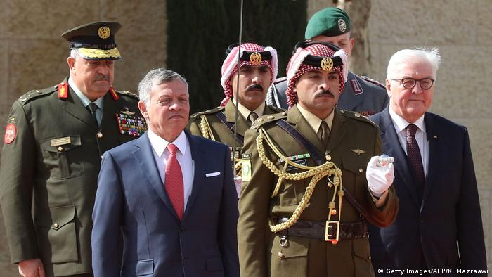 German President Frank-Walter Steinmeier and Jordan's King Abdullah II attend a welcoming ceremony in the capital Amman