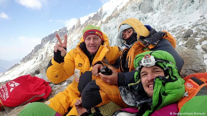 Russian climber Denis Urubko, French climber Elisabeth Revol, and Polish climber Adam Bielecki pose for a picture at the base of the Diamir Face of Nanga Parbat, (Reuters/Adam Bielecki)