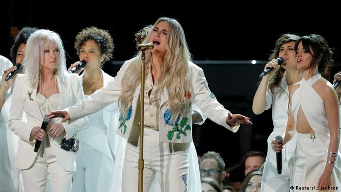 Kesha performs Praying with Cyndi Lauper (L) and Camila Cabello (R) (Reuters/L. Jackson)