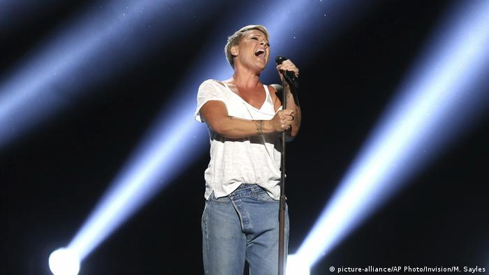Pink performs Wild Hearts Can't Be Broken at the 60th annual Grammy Awards at Madison Square Garden with spotlights in the background
