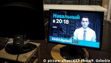 18.05.2017 In this photo taken on Thursday, May 18, 2017, the picture of Russian opposition leader Alexei Navalny is displayed on the screen after a live broadcast at the office of theFoundation for Fighting Corruption in Moscow, Russia. Blacklisted by state-owned media, Navalny is tapping into the resources of YouTube. The broadcasts have become a key piece of Navalny's strategy to galvanize opposition to President Vladimir Putin and the upper echelons of power that he says are awash in corruption. The videos regularly attract more than a million views and contribute to the opposition's resurgence after years of being marginalized and riddled by internal disputes.(AP Photo/Pavel Golovkin) |
