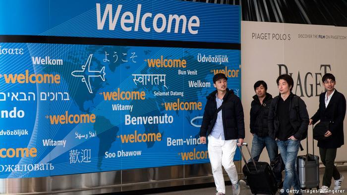 Travelers arrive at the international terminal at John F. Kennedy International Airport