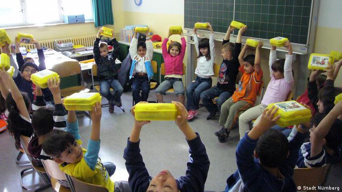 School children in Nuremberg with yellow lunch boxes