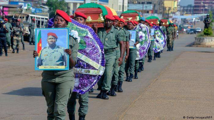 Soldiers carry coffins of soldiers killed in November last year
