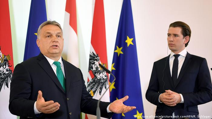Hungarian Prime Minister Viktor Orban gestures with at press conference Austrian Chancellor Sebastian Kurz looking on
